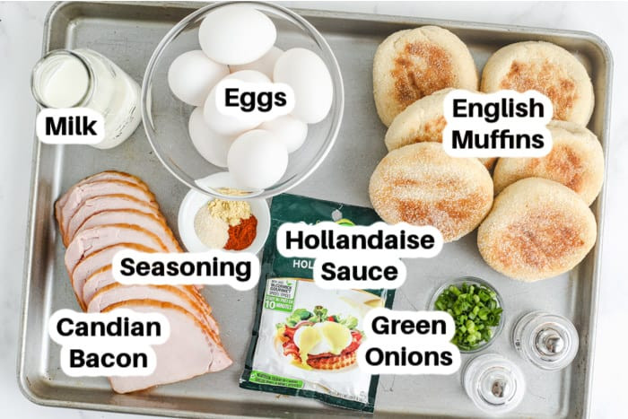 ingredients for eggs benedict on a tray labelled
