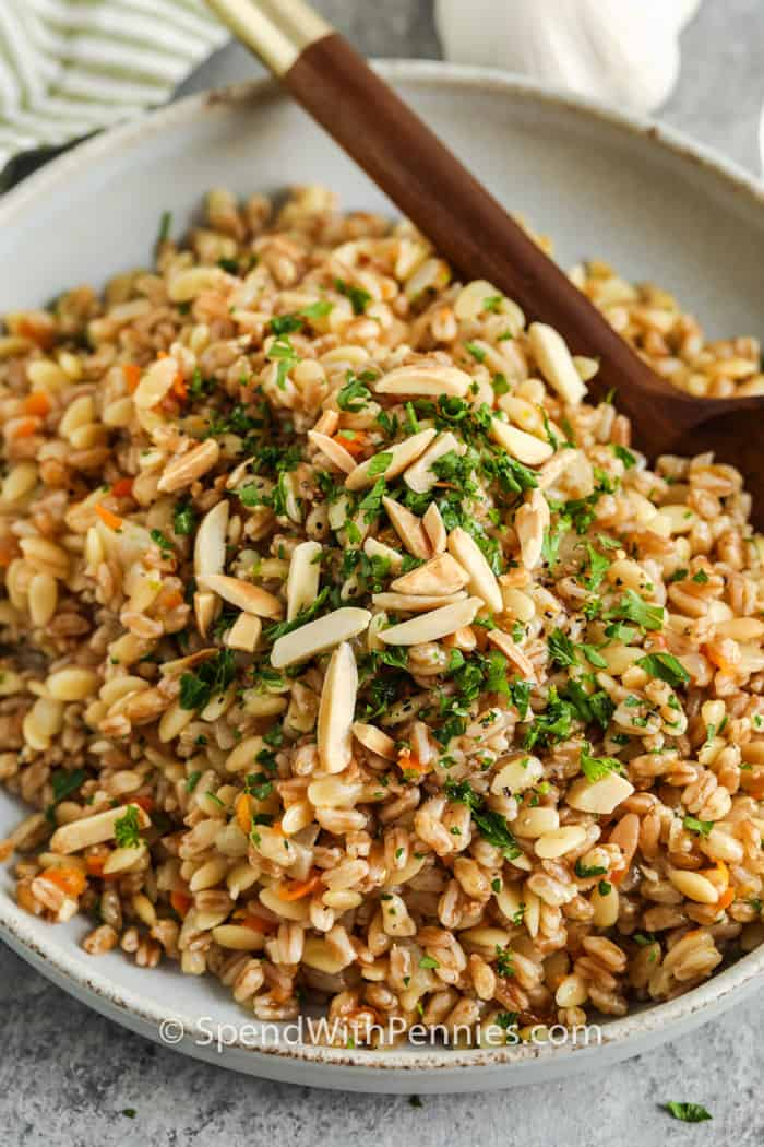 close up of Farro Pilaf with nuts and garnish on top