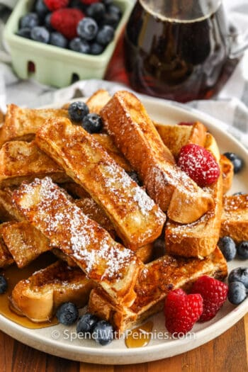 plated French Toast Sticks with icing sugar on top