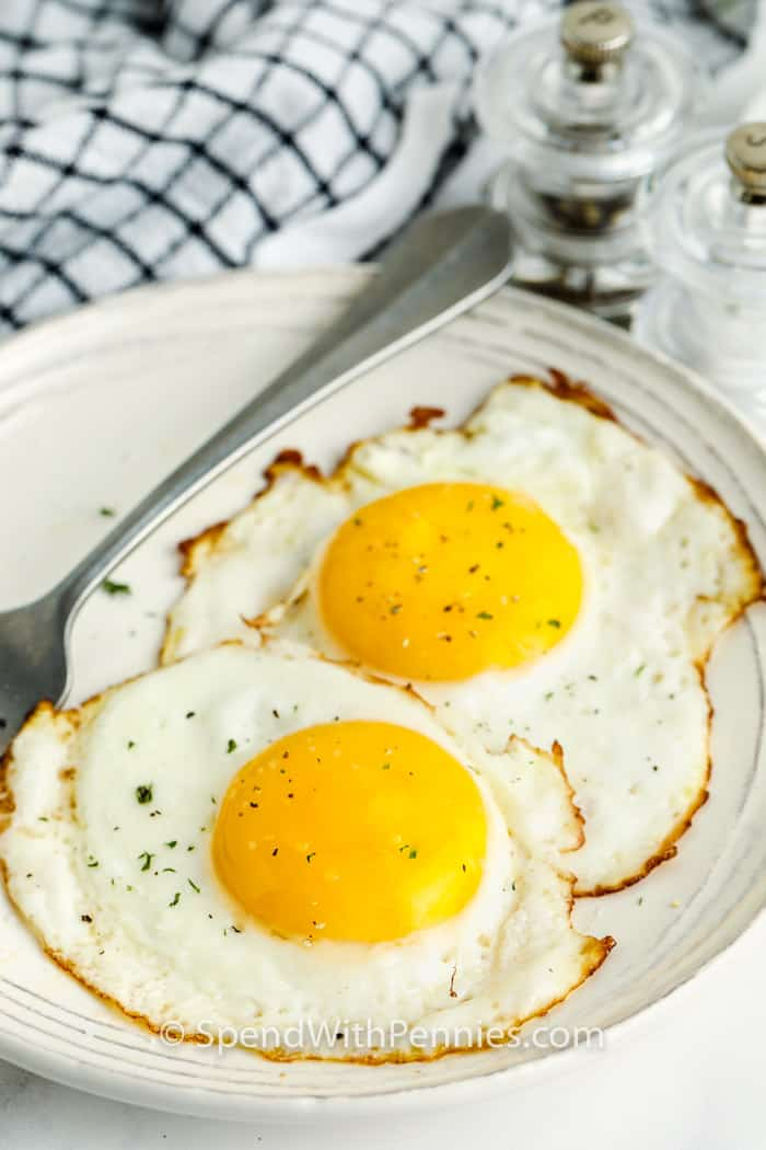 Fried Eggs on a plate with a fork