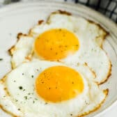 Fried Eggs on a plate with salt and pepper