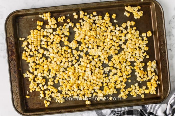 corn on a baking sheet to show How to Freeze Corn