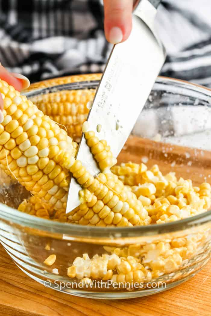 cutting off corn to show process of How to Freeze Corn
