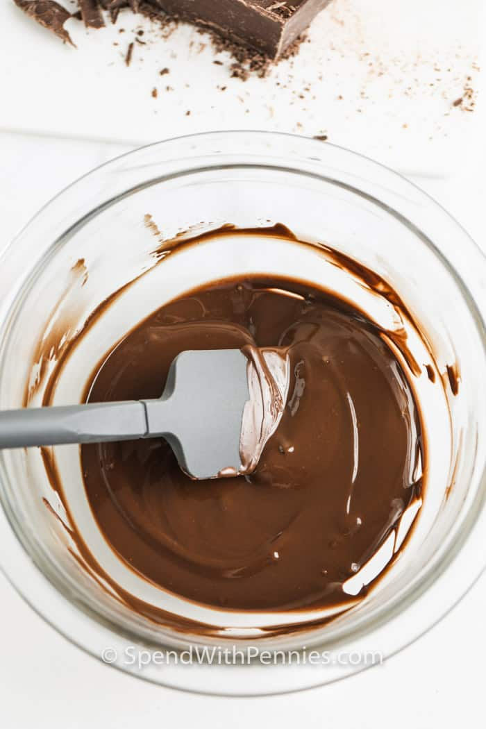 melted chocolate in a glass bowl to show How to Melt and Temper Chocolate