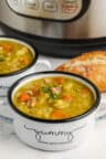 Instant Pot Split Pea Soup in bowls with instant pot in the back