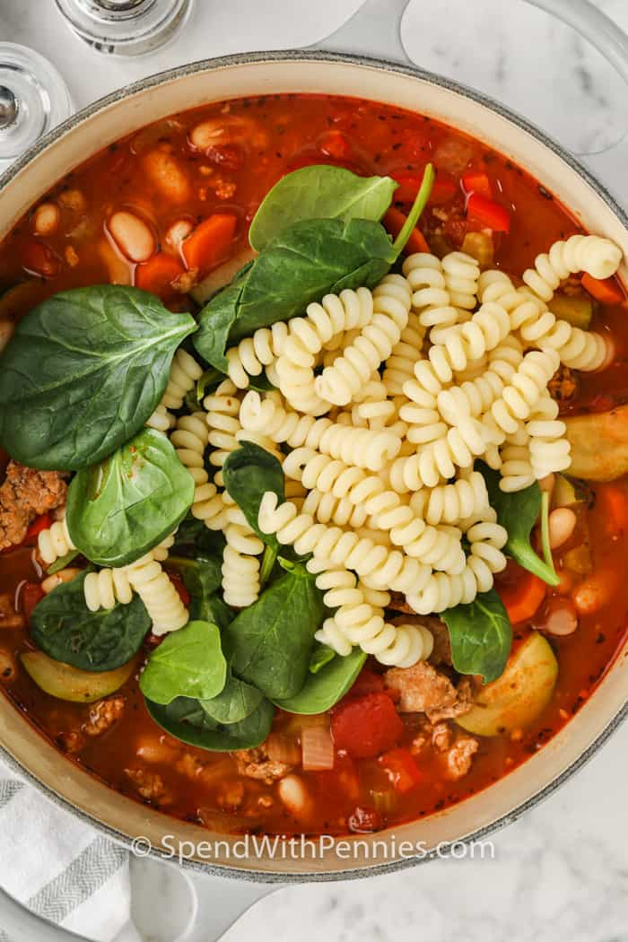 adding pasta to Italian Sausage Soup