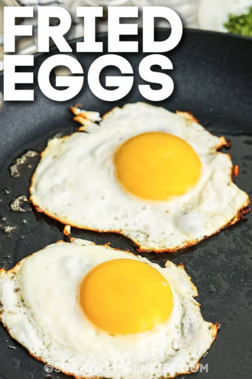 Fried Eggs cooking with a title