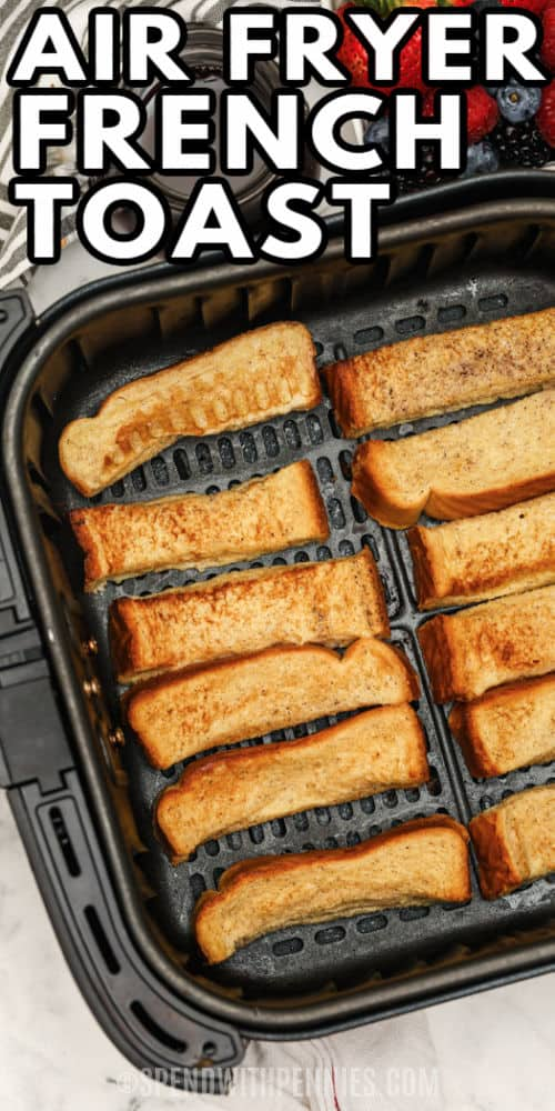 Air Fryer French Toast Sticks cooked in the air fryer with a writing