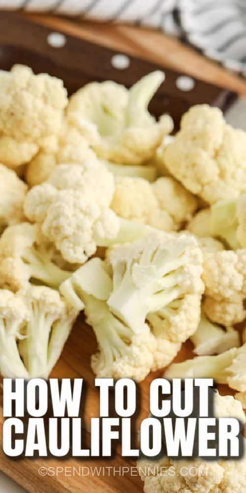 cauliflower on a cutting board to show How to Cut Cauliflower with a title
