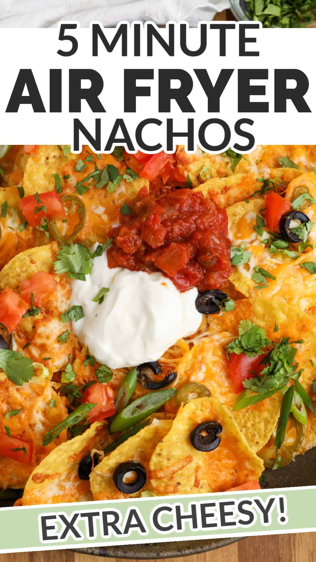 Air Fryer Nachos in the air fryer and plated with a title