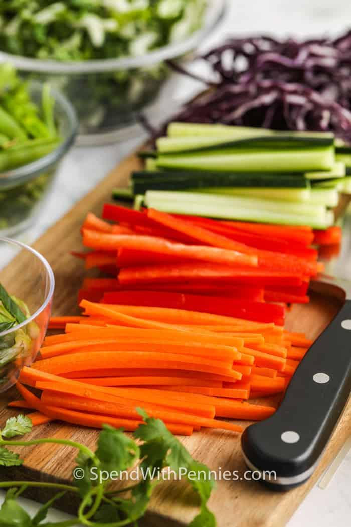 cutting vegetables to make Sesame Ginger Noodle Salad