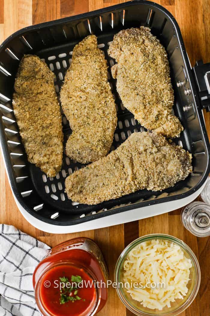 breaded chicken in the air fryer to make Air Fryer Chicken Parmesan