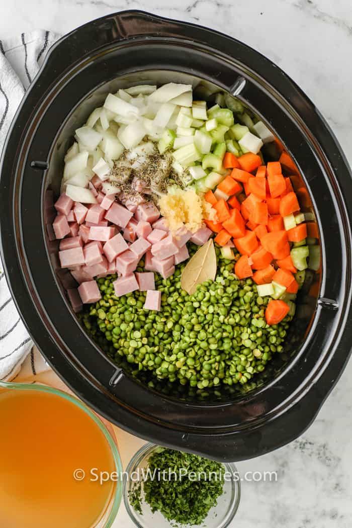 ingredients in a crockpot to make Crockpot Split Pea Soup