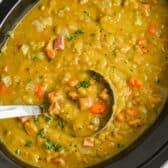 Crockpot Split Pea Soup with a laddle in the crock pot