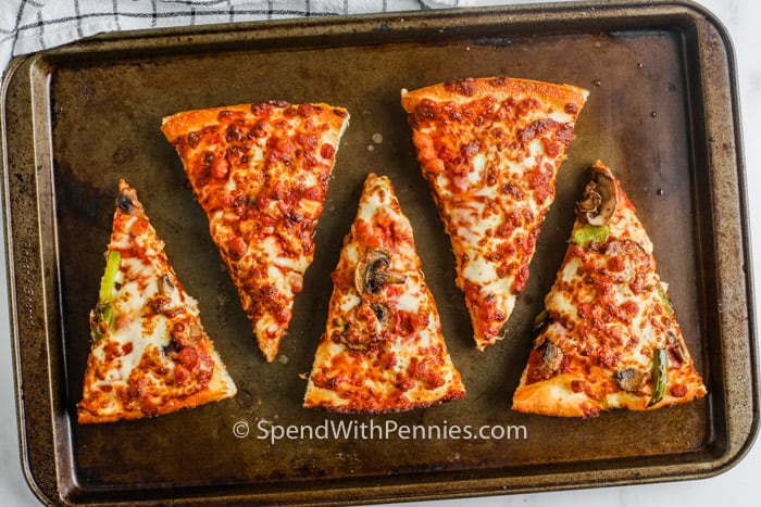 pizza on a baking sheet to show How to Reheat Pizza