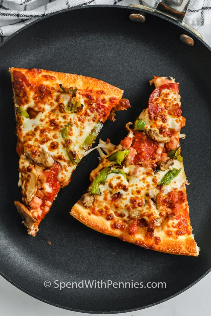 pizza on a pan to show How to Reheat Pizza