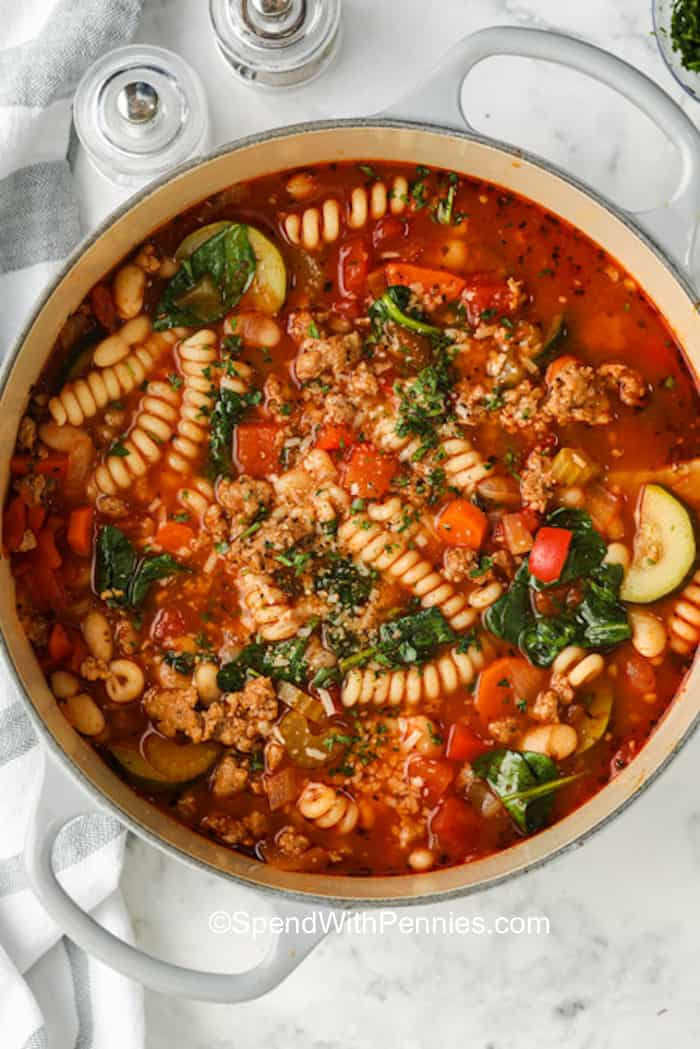 A pot of Italian sausage soup with pasta