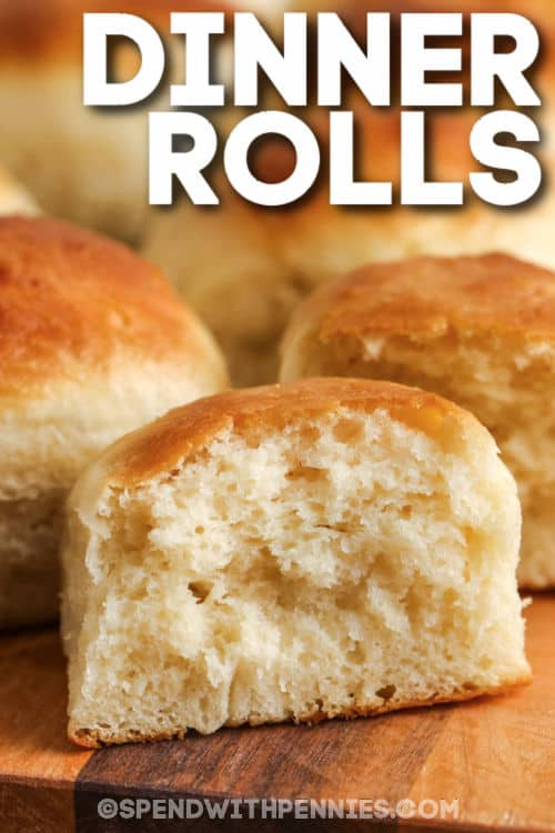 close up of Dinner Rolls with one in half and a title