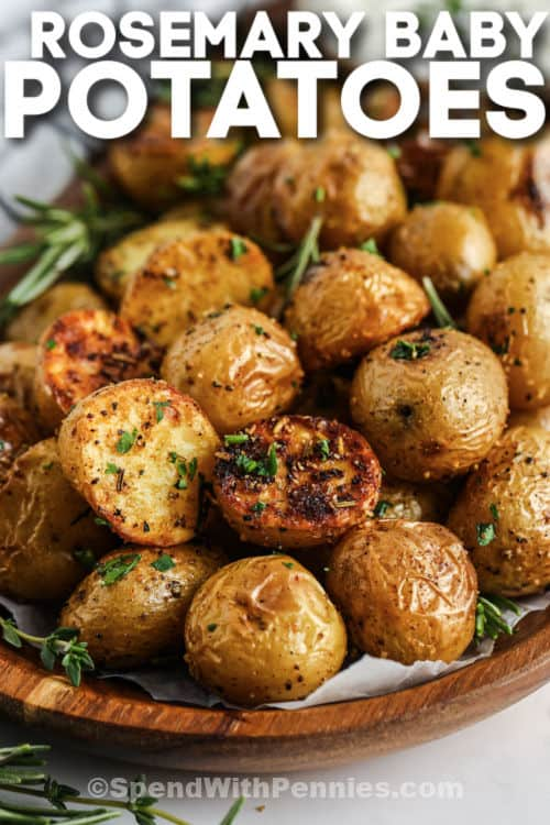 garnished Rosemary Baby Potatoes on a plate with writing