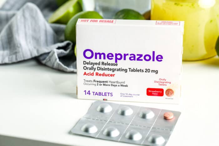 ODT medication on a counter next to limes