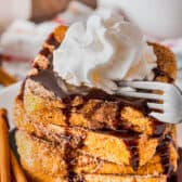 taking a piece of Nutella Stuffed Churro French Toast with a fork