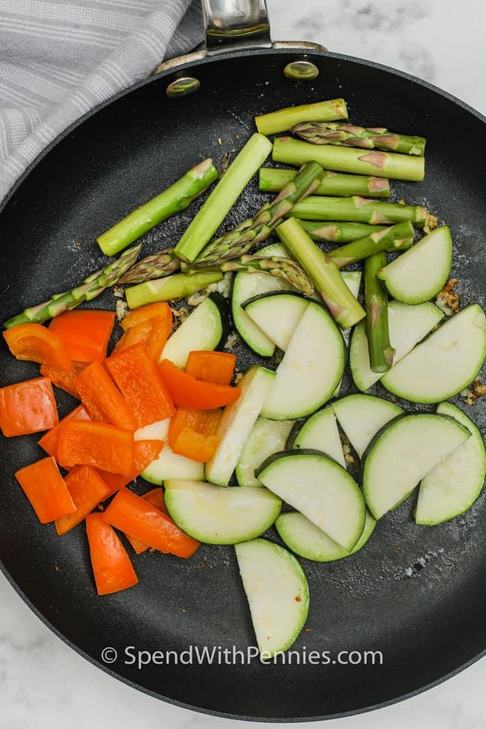 cooking vegetables to make Pasta Primavera
