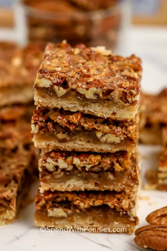 Stack of Pecan Pie Bars on a white plate