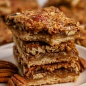 Pecan Pie Bars in a stack on a plate