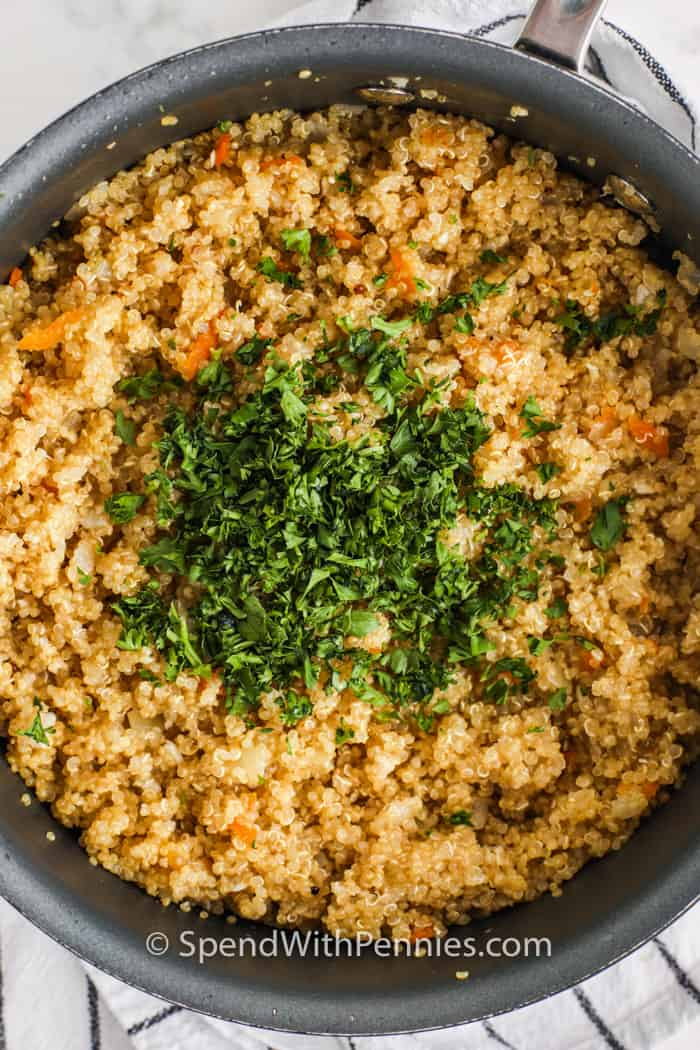 Quinoa pilaf in a pan with parsley