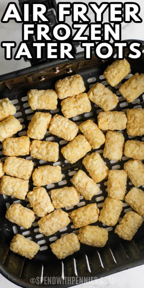 Air Fryer Frozen Tater Tots in the air fryer before cooking with a title