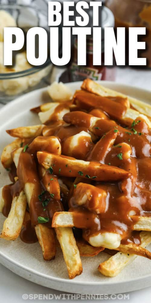 plated Poutine with garnish on top and a title