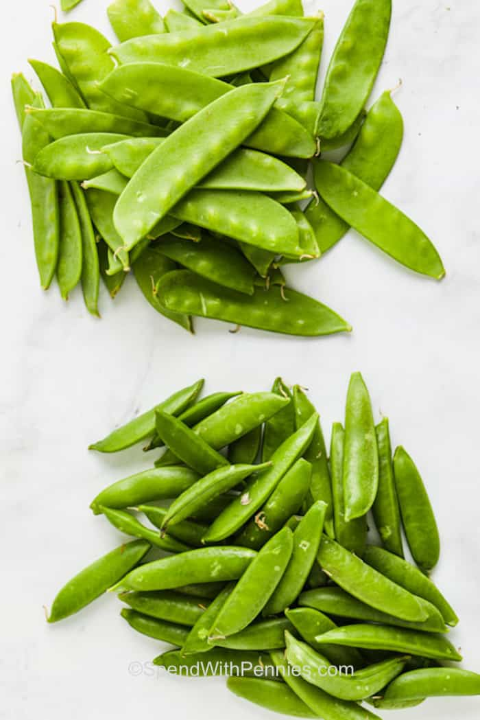 Snow peas and snap peas on the counter