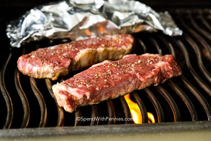 Steaks being grilled