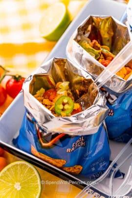 a taco in a dorito bag with a fork