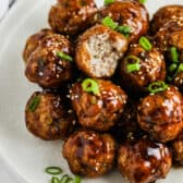 Hoisin Glazed Meatballs with a bite taken out of one