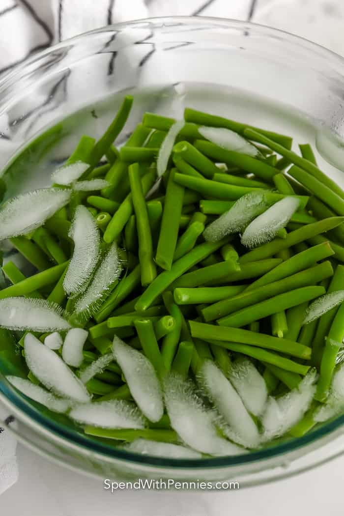 green beans in a bowl with water and ice