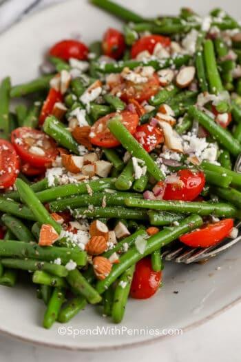 close up of green bean salad on a dish