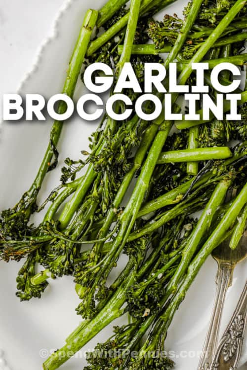 Garlic Broccolini on a plate with a fork and writing