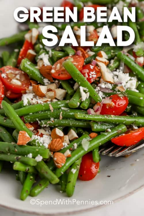 close up of green bean salad on a dish with text