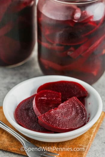 plated Quick Pickled Beets with jars full in the back