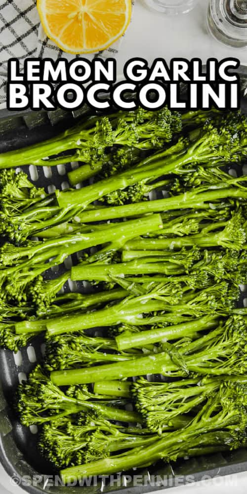 Air Fryer Broccolini in the fryer before cooking with a title