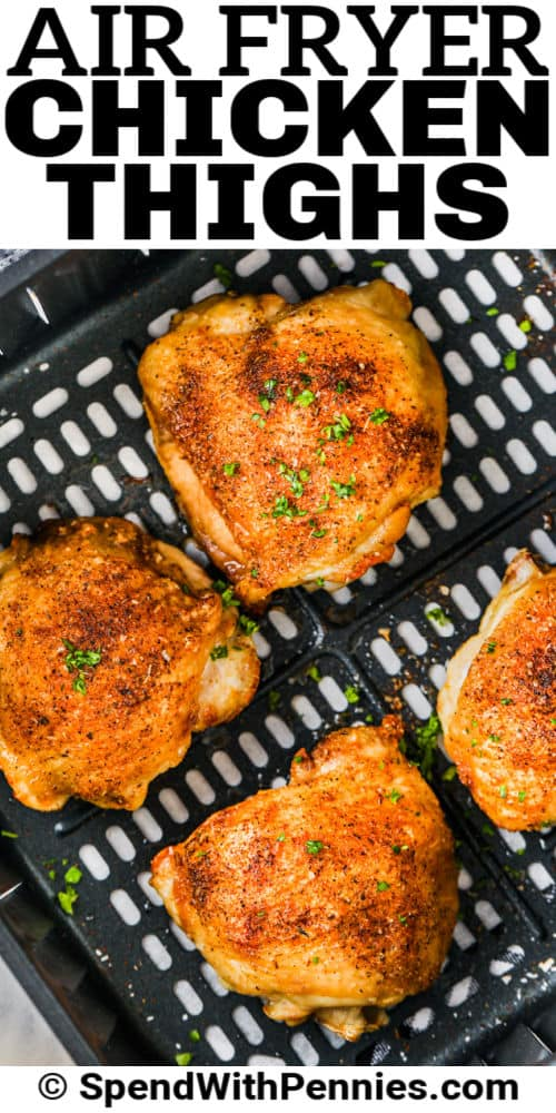 cooked Air Fryer Chicken Thighs in the air fryer with writing