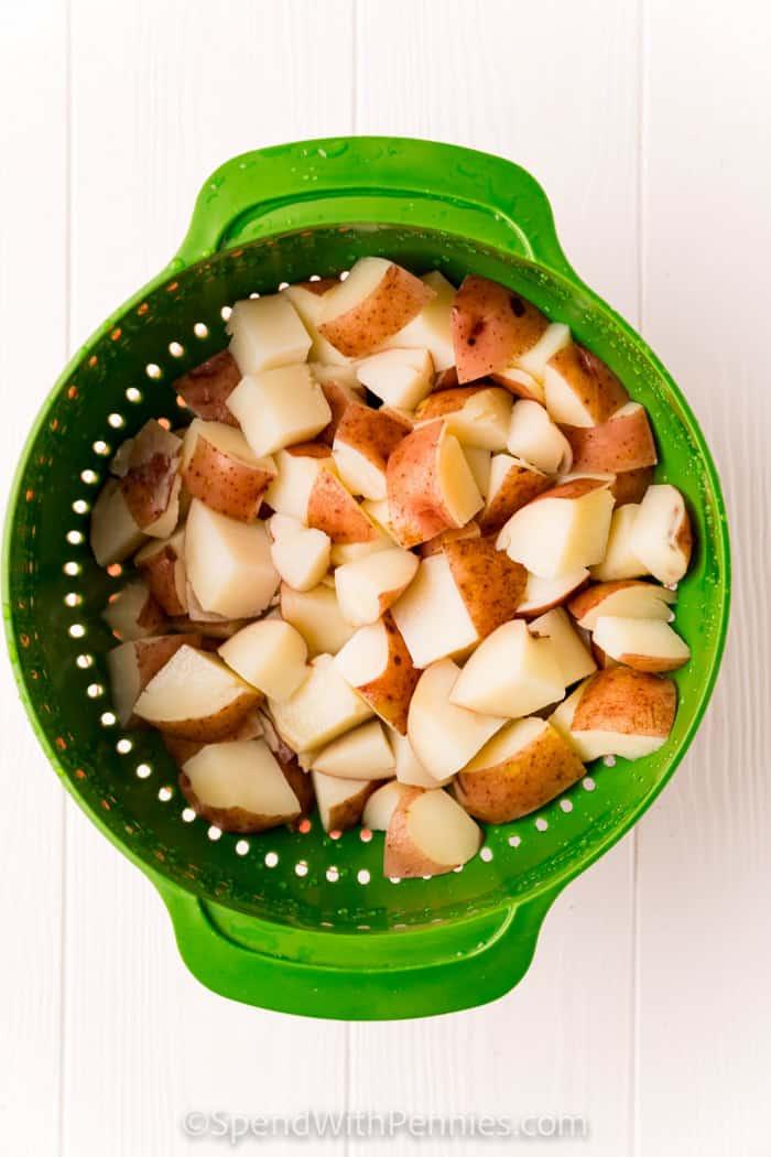 potatoes in a colander for Bacon Ranch Potato Salad