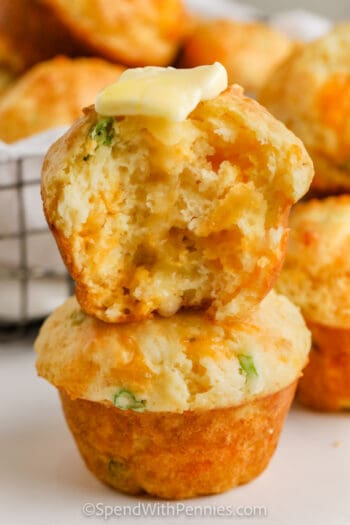 Cheese Muffins (Quick Bread) with one in half and butter on top