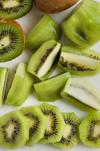 top view close up of cut kiwi to show How to Cut Kiwi