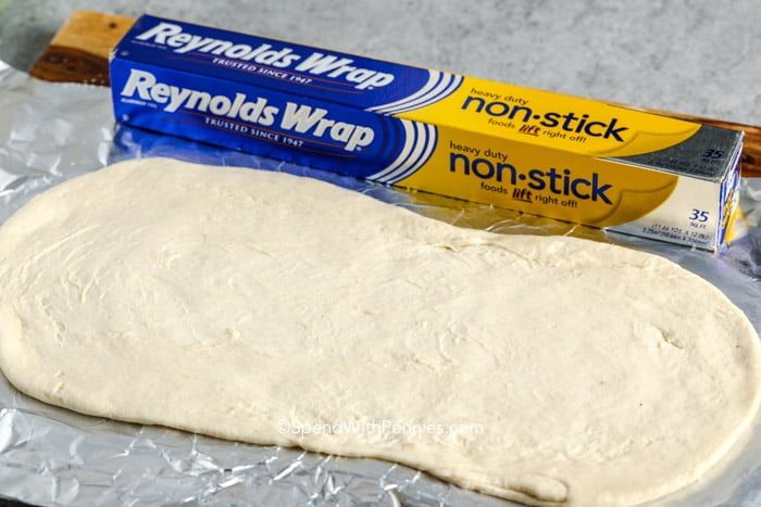 pizza dough on tin foil with the Reynolds tin foil on the side