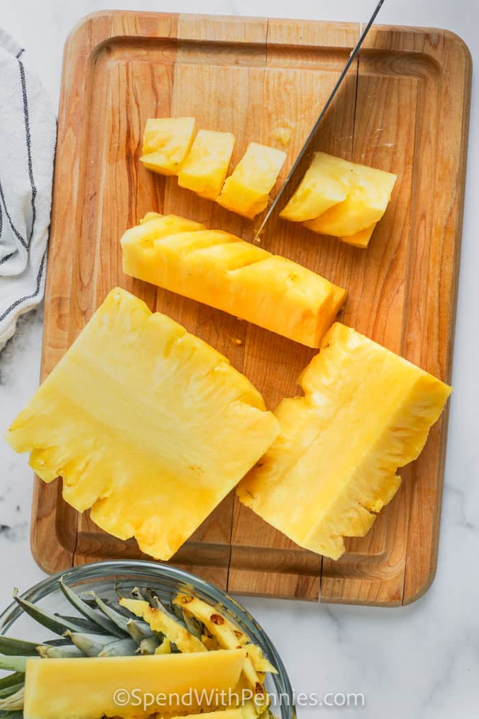 cutting pineapple into spears and chunks
