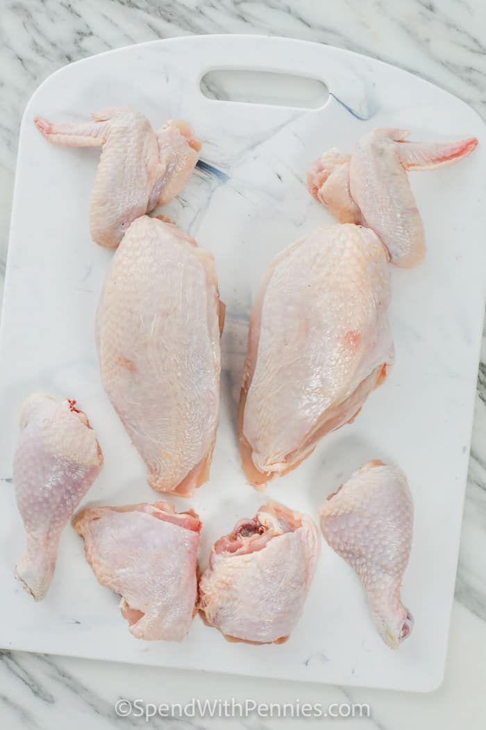pieces of chicken on a cutting board to show How to Cut a Whole Chicken