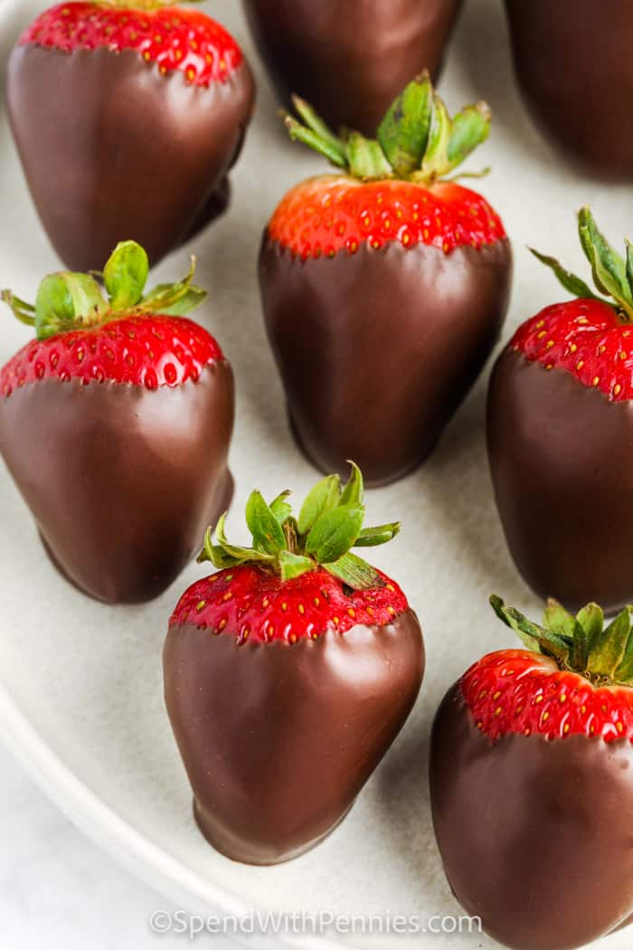 How to Melt and Temper Chocolate and put on strawberries on a plate