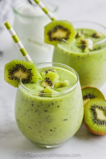 Kiwi Smoothie in a glass with pieces of kiwi as garnish